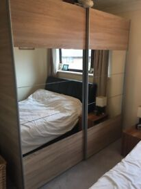 Double door light oak wardrobe with mirrored doors