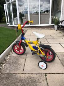 Bike with stabilisers. Age up to probably 5, maybe 6?