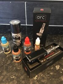 Arc e cigarette with a selection of juices