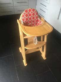 Wooden high chair with padded insert