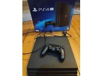 PS4 Pro with box + 2 games