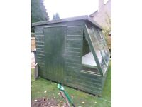 Greenhouse 10x8ft, 4 large sloping windows, side door, roof slopes to rear, good general condition