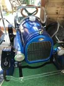 Pedal, metal, classic looking ride on car.