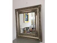 Ornate silver baroque style mirror