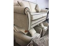 311 **NEW** 3 seater cream fabric sofa with two armchairs