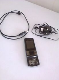 Samsung GT C3050 - Black (Unlocked) Mobile Phone--- charger ---headphones--- U S B cable