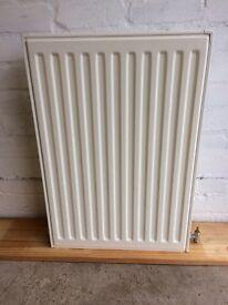 2 double panel convector radiators. One 480mm wide x 700mm high, and one 900mm wide x 600mm high