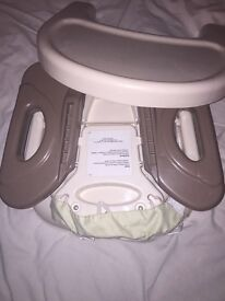 Safety booster seat with tray