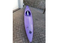 Kayak with paddle, spray deck and helmet