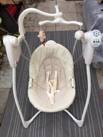 Baby swing, swinging chair.
