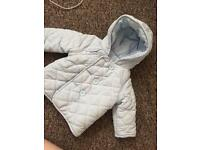 Bundle of baby coats and pramsuits