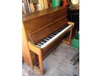 Upright Piano with piano stool and music books