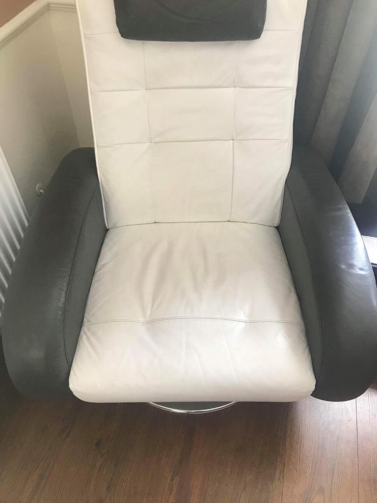 Brown And White Leather Spinning Chair