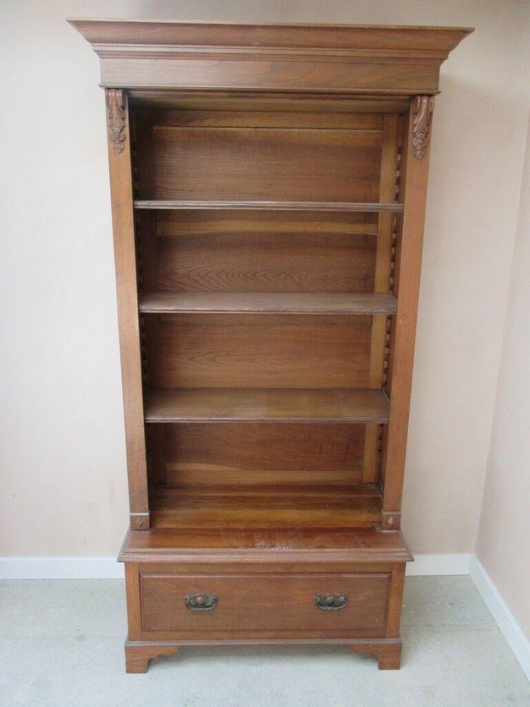 Ornate Oak Bookcase With Adjustable Shelving And Deep Lower Draw.