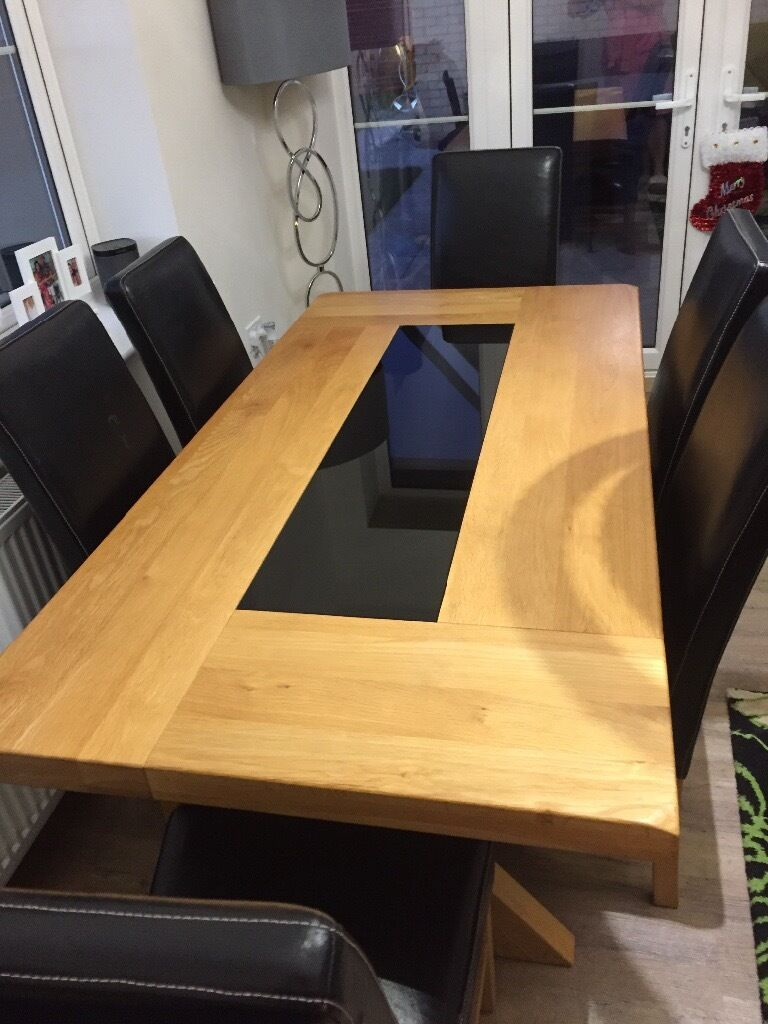 Solid Oak Dining Table With Black Glass Inset. 6 Black Faux Leather Chairs
