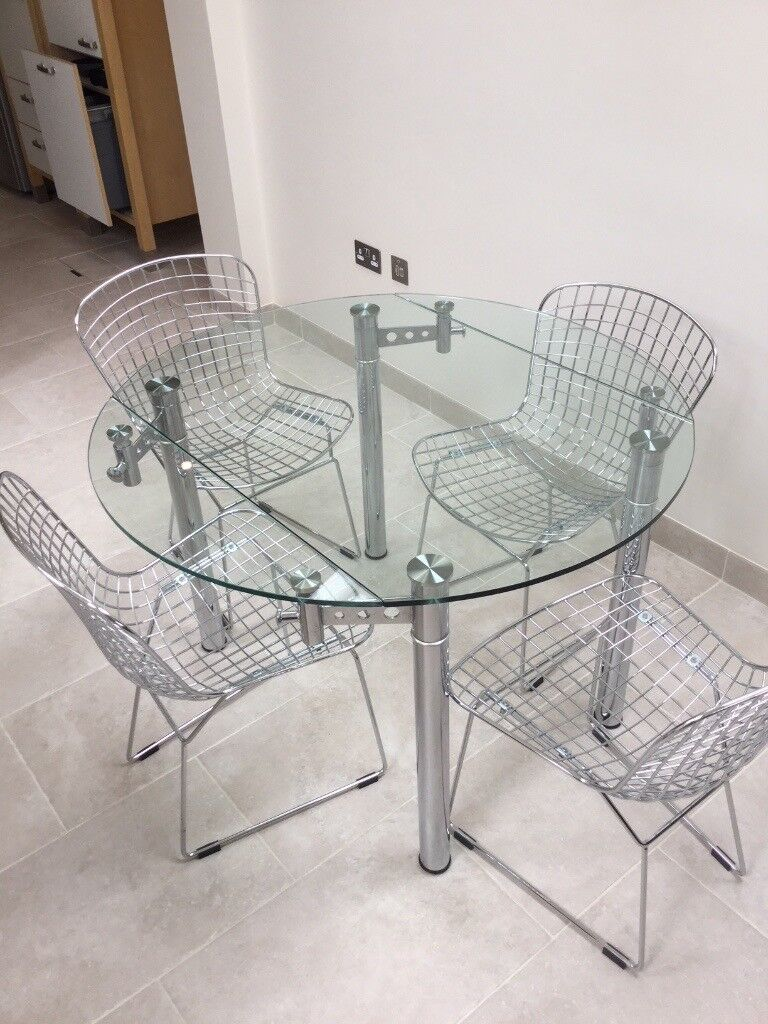 Glass Dining Table And 70s Style Wire Designer Chairs