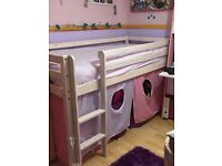 girls whote wooden cabin bed with pink and lilac curtains