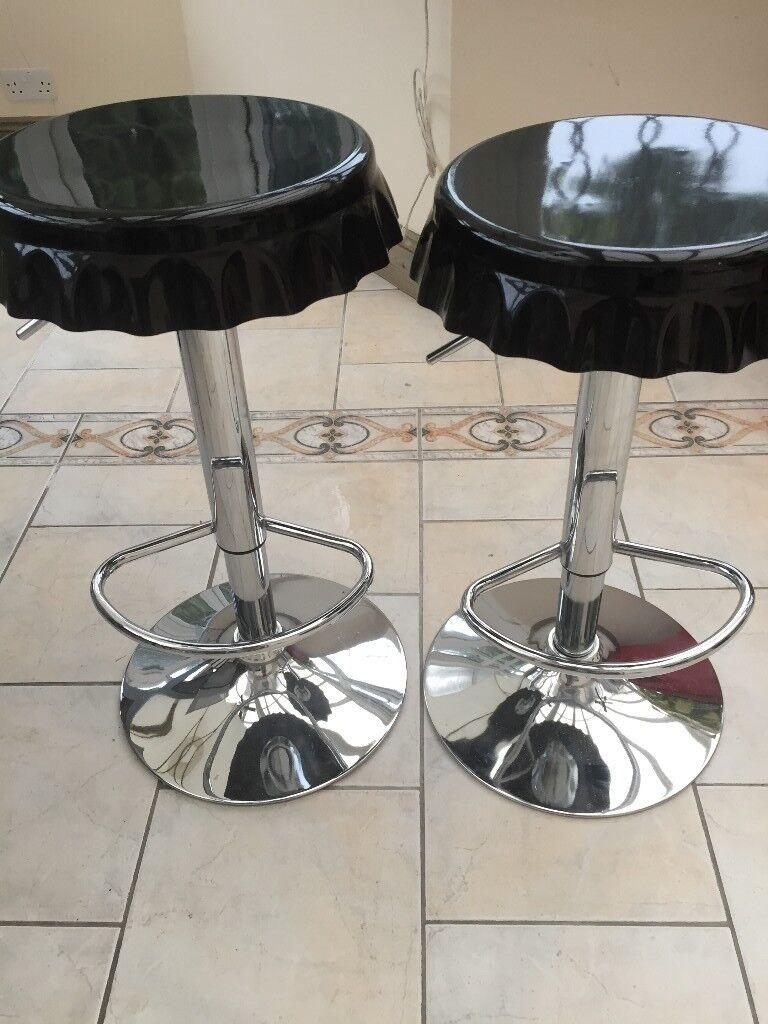 2 X BAR STOOLS WITH BLACK COKE BOTTLE TOP SHAPED SEATS