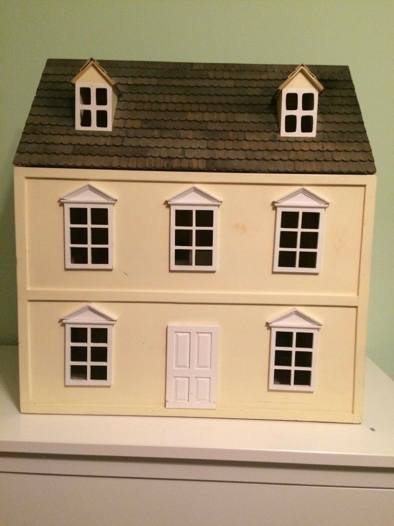 Wooden Dolls House With Wooden Furniture And Doll Family.