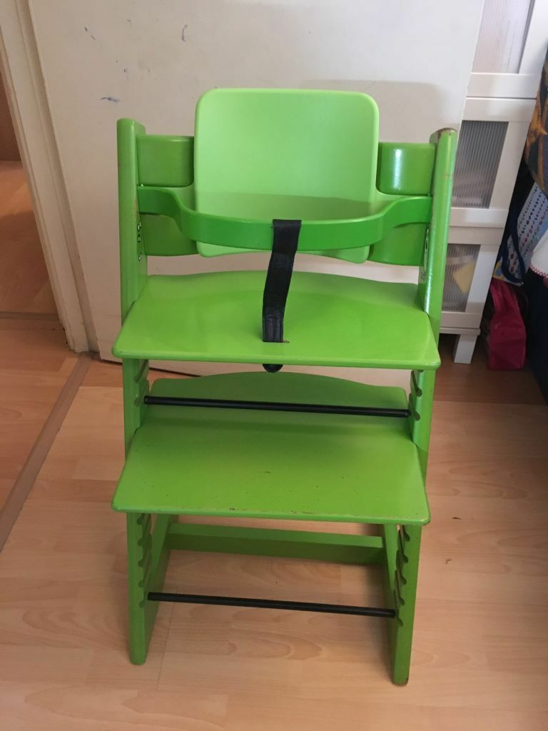 STOKKE LIME GREEN HIGH CHAIR £55.00 INCLUDES BABY SET. ADJUSTABLE SEAT AND  FOOT REST