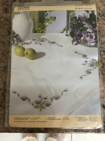 Cross stitch kit, new, still in wrapper. Table cloth 31 x 31 ins square.