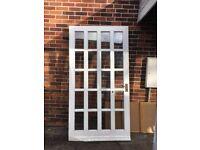 2 Heavy Wooden Doors for sale. One internal single glazed, one external double glazed.