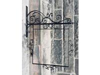 Ornate wall sign bracket