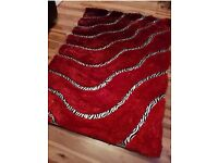 Brand new sealed red stunn8ng rug for sale