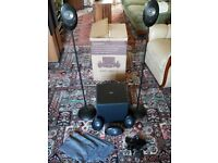 KEF KUBE 1 powered amplifier with KEF surround speakers and stands
