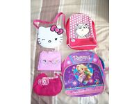 Bundle of girls backpacks and handbags