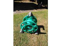 Freestanding garden hose stand