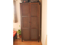 Timber wardrobe with wicker panelling