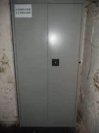One double grey steel office storage cupboards with internal shelving in good condition