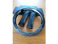 Steering wheel cover with matching belt covers
