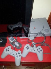 Playstation one & playstation two bundles with games and steering wheel & pedals (bargain)