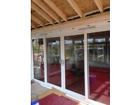 Very long sliding patio doors with glass side panels.