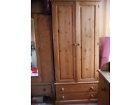 Pine wardrobe with two drawers.