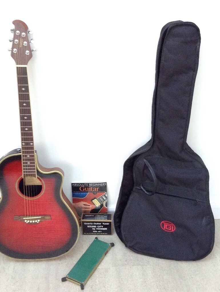 Tanglefoot Odyssey TMO-7W Electric/Accoustic Guitar with Accessories Shown