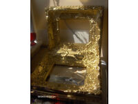 pair of vintage picture frames in gold