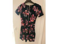Ladies navy flower play suit .