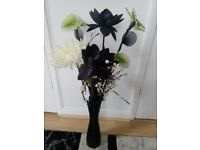 ARTIFICIAL FLOWERS IN A BLACK VASE