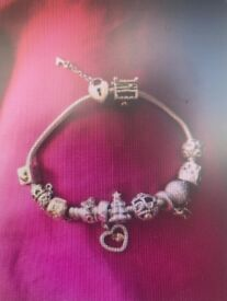 Genuine Pandora silver bracelet with gold clasp and 11 charms