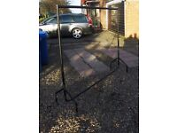 BLACK CLOTHES RAIL ON CASTORS 6 FOOT WIDE 5 3 FOOT HIGH GOOD CONDITION IDEAL MARKET OR CAR BOOT SALE