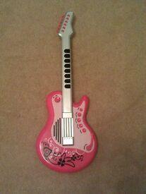 Pretty pink girls rockstar guitar with cool rockstar glasses & microphone