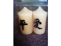A VERY NICE SET OF TWO LOVELY CANDLES IN A CLEAR BOX