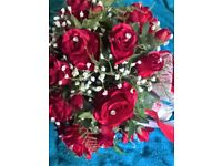 red rose posy with diamantes fern and gyp.