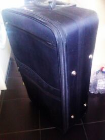 VERY NICE AND LARGE EXPANDABLE BLACK TROLLEY SUIT- CASE ON TWO SMOOTH WHEELS