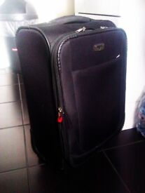 TRULY LOVELY LUXURIOUSLY GOOD QUALITY ORIGINAL TROLLEY SUITCASE ON FOUR WHEELS