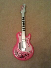 Cool pink guitar with funky rockstar glasses and microphone