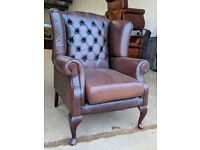 Antique brown chesterfield wingback chair